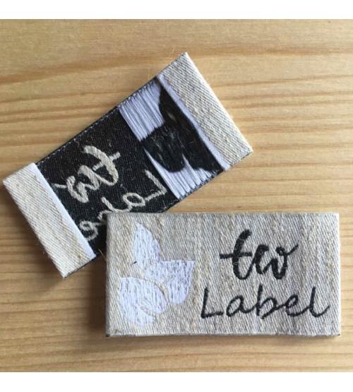 Etiquette vêtement tissée lin et polyester recyclé : lin écru, polyester recyclé noir, polyester recyclé blanc