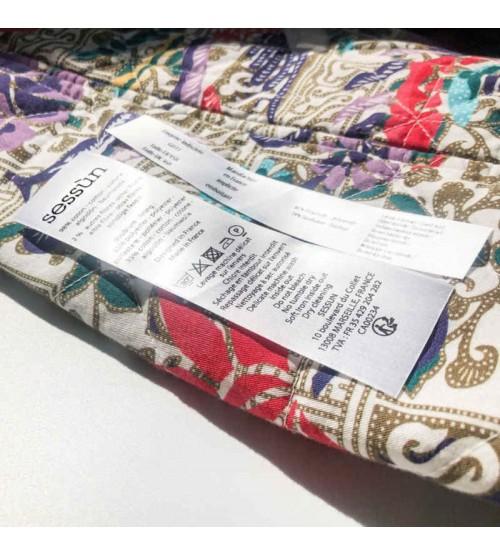 Sessun : étiquette entretien vêtement fond blanc